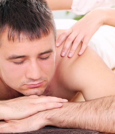 Young and handsome guy enjoying massage therapy Stock Photo - 14362405