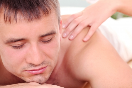 Handsome man relaxing and enjoying procedure of massage Stock Photo - 14362730