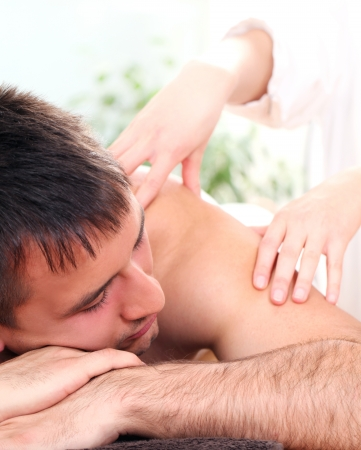 Young and handsome guy enjoying massage therapy Stock Photo - 14362389