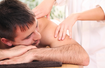 Handsome man relaxing and enjoying procedure of massage Stock Photo - 14362553