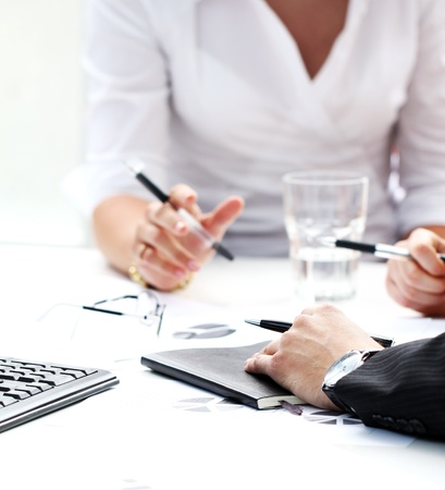 Close-up van het werk proces op zakelijke bijeenkomst