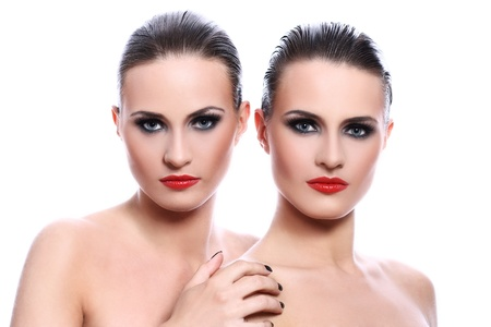 Portrait of two beautiful women over white background photo
