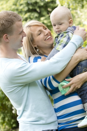 Young and happy family have fun in the park photo