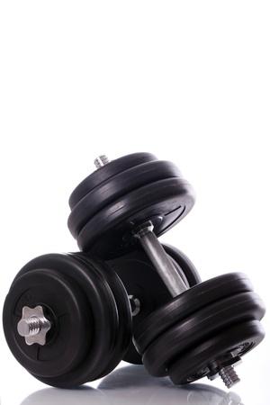 Big black dumbells over white background photo