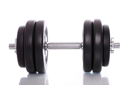 levantar pesas: Grandes dumbells negras sobre fondo blanco