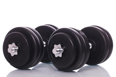 Big black dumbells over white background photo
