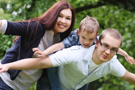 Happy and young family in the park photo