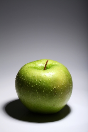 Fresh green apple over gray gradient photo