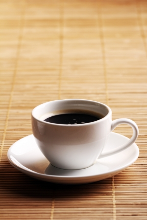 Cup of hot coffee on wooden surface Stock Photo - 14362799