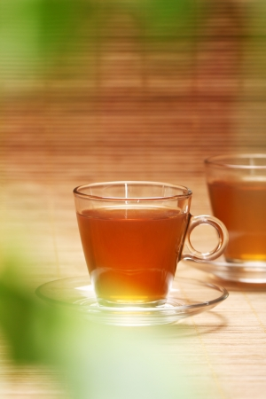 Hot and fresh tea over wooden surface photo