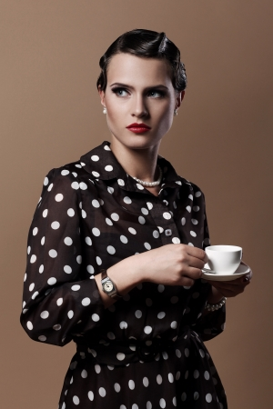 Beautiful vintage woman with cup of coffee photo