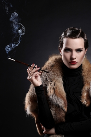 Beautiful woman with cigarette in vintage image Stock Photo - 14520141