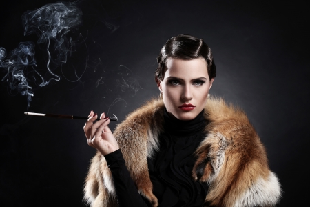 cigarette smoke: Beautiful woman with cigarette in vintage image