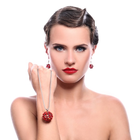 Young and beautiful woman with red jewelry over white background Stock Photo - 14519741