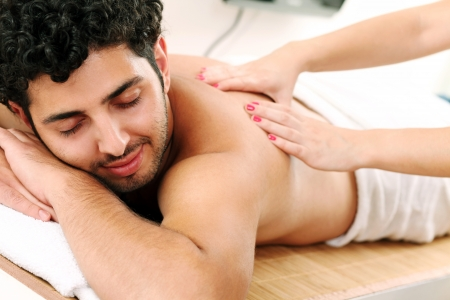 Young and handsome guy enjoying massage therapy  Stock Photo - 14520268