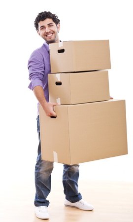 Young and handsome guy carrying boxes over white background photo