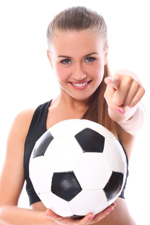 Young and sexy girl with soccer ball over white background photo