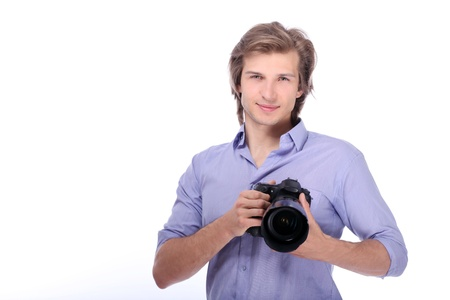 Young man with camera over white background photo