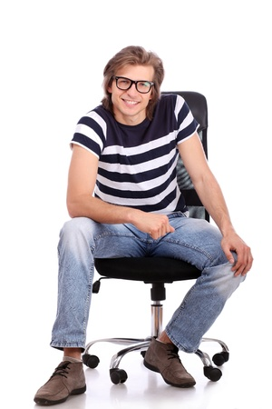 Young and handsome guy sitting on the chair  over white backround photo