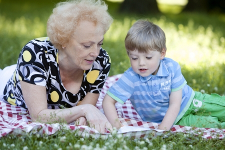 Grandmother with her little grandson in the park photo