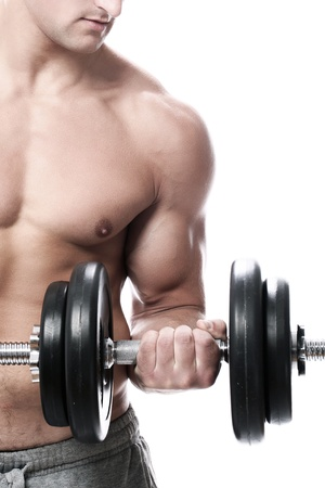 weight:  Muscular guy doing exercises with dumbbells over white background