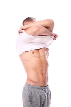 show off: Muscular guy taking off his shirt over white bacground