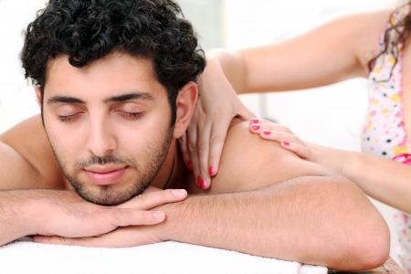 Young and handsome guy enjoying massage therapy Stock Photo - 14780751