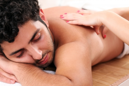 Young and handsome guy enjoying massage therapy Stock Photo - 14780748