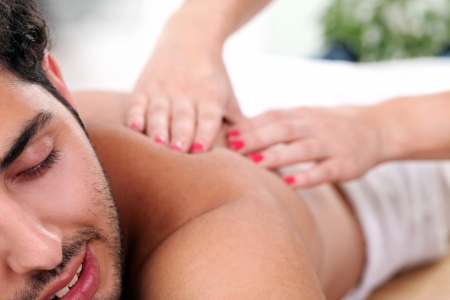 Young and handsome guy enjoying massage therapy Stock Photo - 14780705