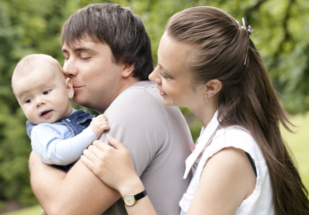 Young and happy family get stroll in the  park photo