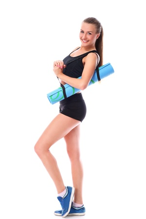 Young smiling woman holding mat for fitness over white background Stock Photo - 14780658