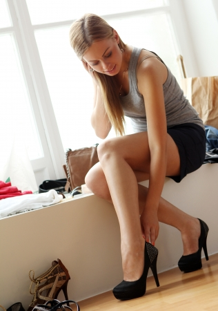 high heel: Young and beautiful  woman wearing new shoes