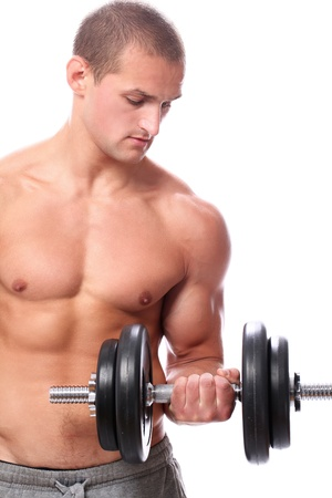 man lifting weights:  Muscular guy doing exercises with dumbbells over white background