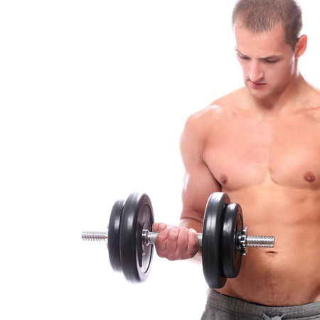 Muscular guy doing exercises with dumbbells over white background photo