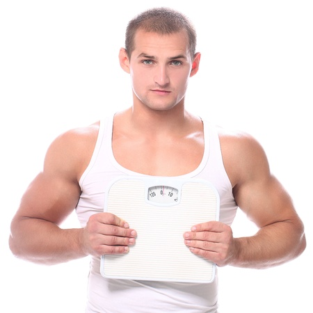 Muscular guy with scales  over white background photo