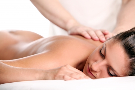 Massage therapy: Beautiful woman enjoying a massage therapy