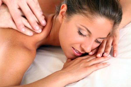 Beautiful woman enjoying a massage therapy photo