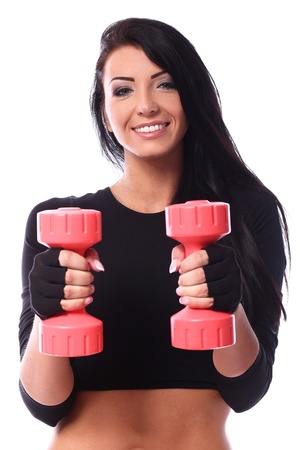 Sexy brunette with dumbbells over white background photo