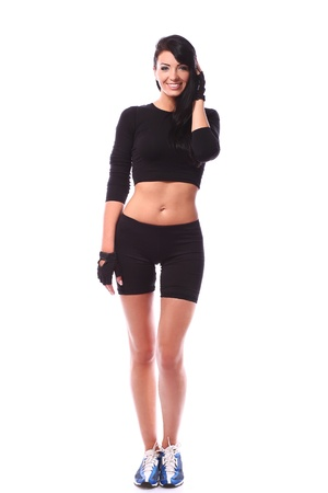 Sexy and smiling fitness woman over white background Stock Photo - 15184101