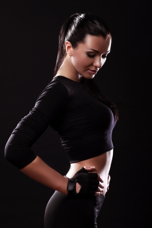 Beautiful fitness girl with sexy body over black background Stock Photo - 15184143