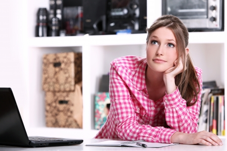 Cute teenager girl styding at the home Stock Photo - 15184182