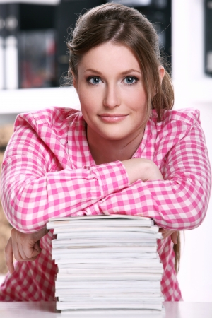 Young and cute student girl at the desk Stock Photo - 15184268