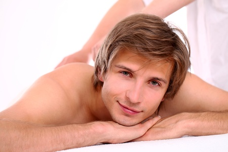 Young and handsome guy relaxing at massage session Stock Photo - 15184205