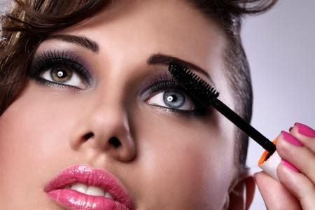 mascara: Close up of woman face with mascara brush  Stock Photo