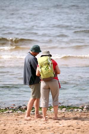Tourist standing near the sea photo