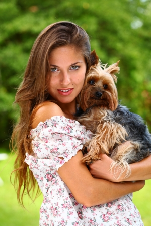 Portrait of beautiful woman with her cute dog photo