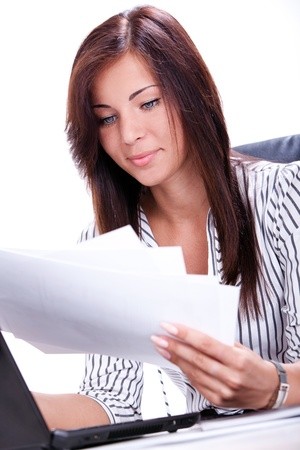 Beautiful business woman doing paperwork in the office Stock Photo - 15547967