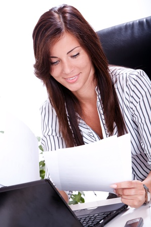 Beautiful business woman doing paperwork in the office Stock Photo - 15547965