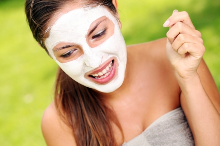 white mask: Young and happy woman with spa mask on her face Stock Photo