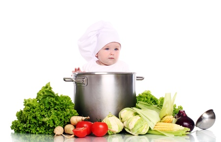 Cute baby chef with big pot and vegetables over white background Stock Photo - 15646415